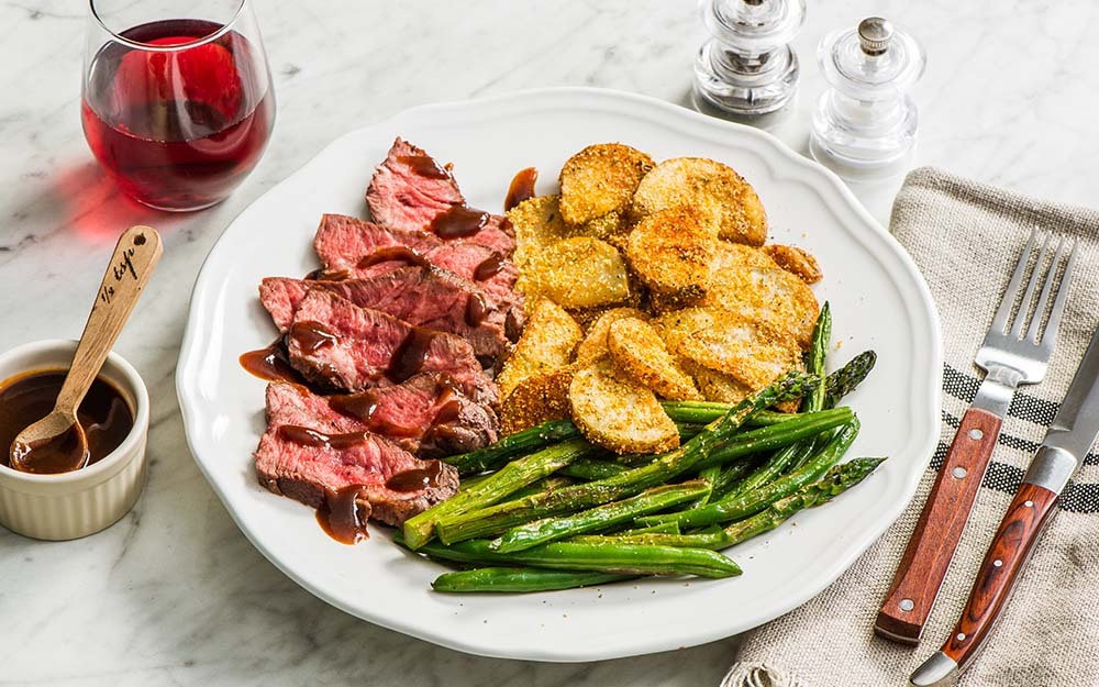 Maple Chipotle Steak with cornmeal-crusted potatoes, asparagus and beans,
