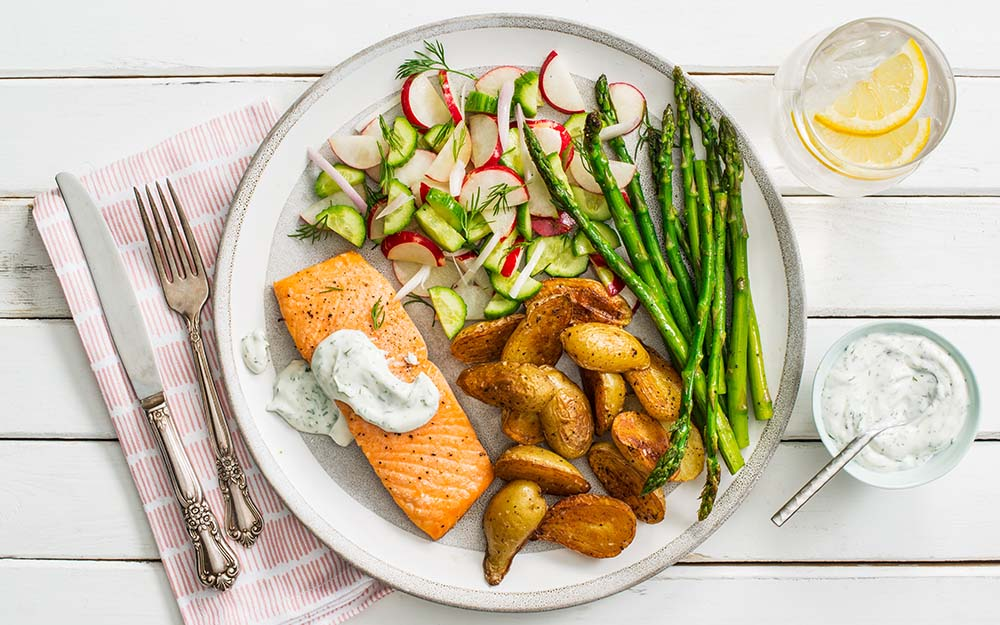 Spring Salmon with roasted asparagus, dill sour cream and crisp cucumber salad,