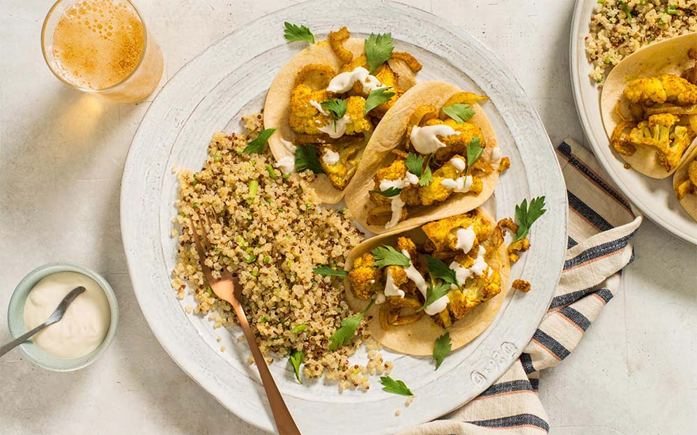 Cauliflower Shawarma Tacos with creamy tahini sauce and a lemony quinoa salad,