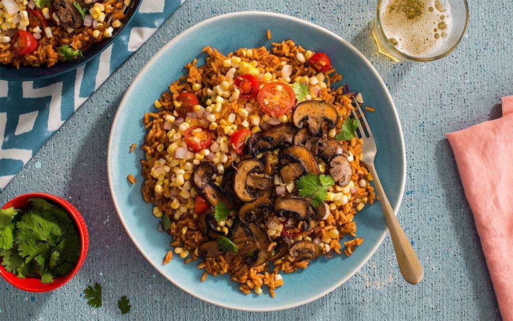 Plant-Powered Portobello Burrito Bowl with Mexican spiced rice and a summer corn salsa,