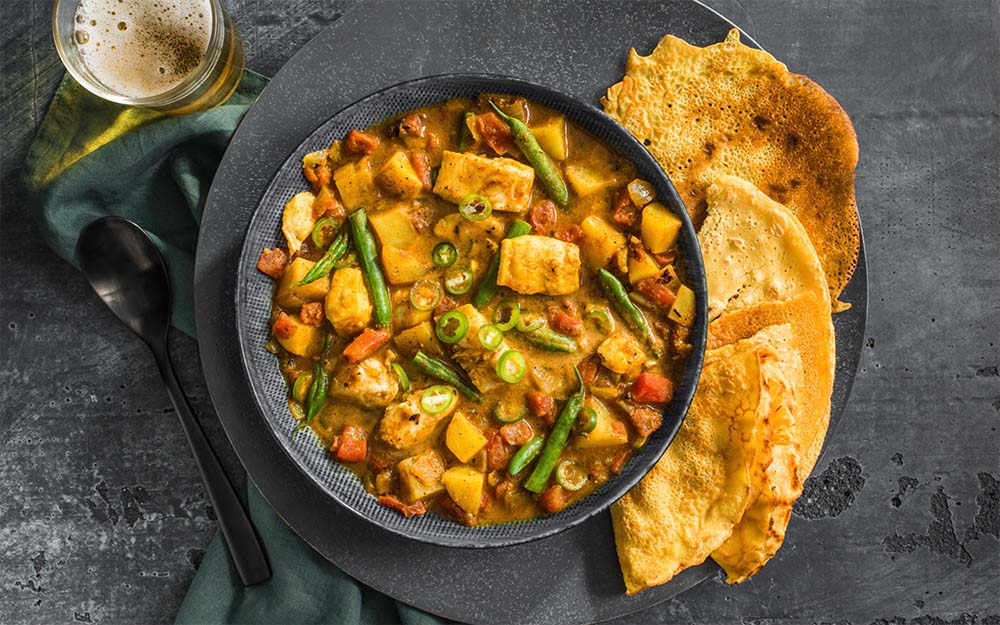 South Indian Fish Curry with potatoes and chickpea pancakes,