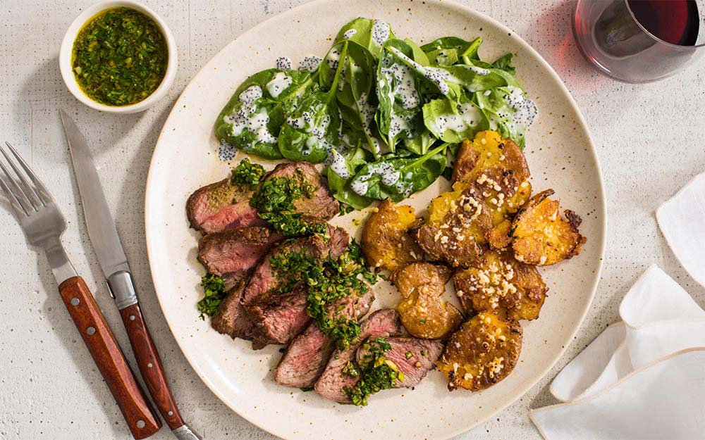 Seared Steak & Lemon-Caper Salsa with parmesan smashed potatoes & a poppy seed salad,