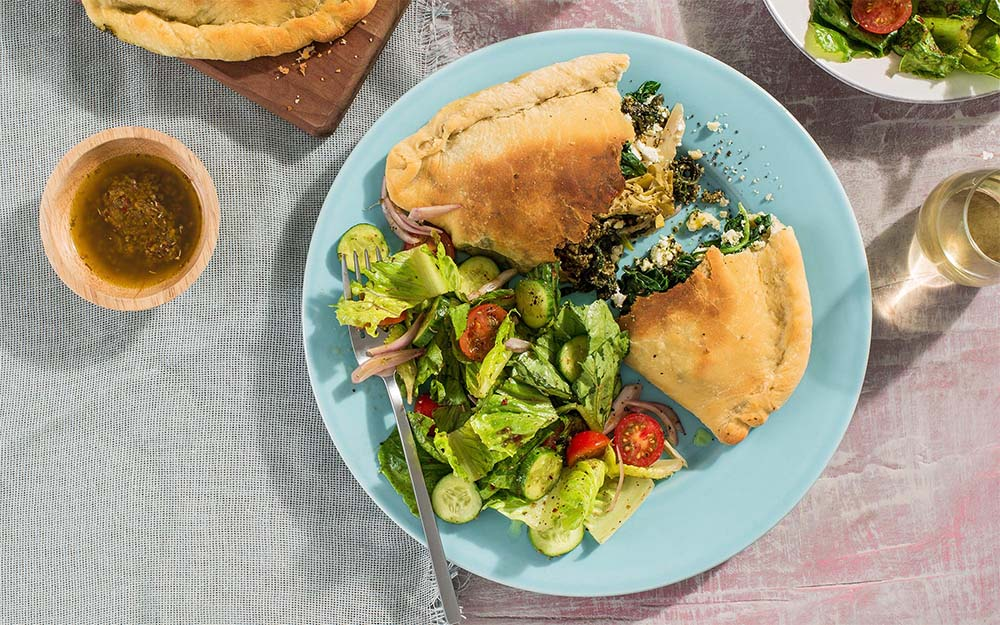 Greek-style Spanakopita Calzones with feta, spinach and a chopped salad, Customer Favourite