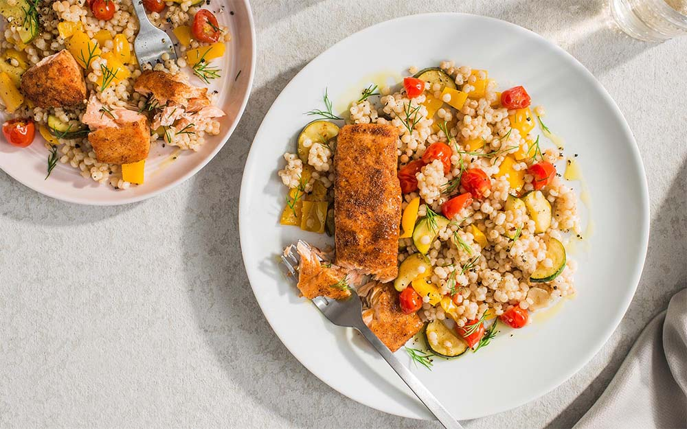 Seared Salmon & Pearled Couscous with sauteed zucchini and peppers,