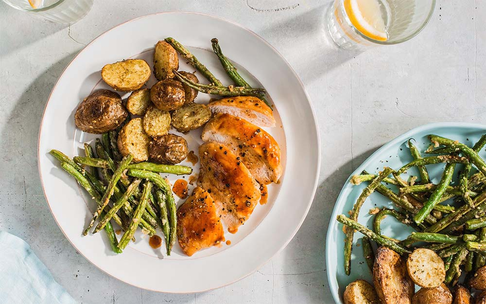 Sticky Maple Glazed Chicken with roasted potatoes & parm-crusted green beans,