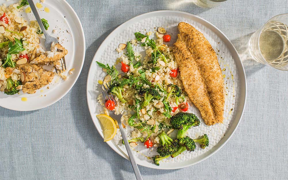 Sumac Spiced Fish & Lemon Roasted Broccoli with couscous and sweet drop peppers,