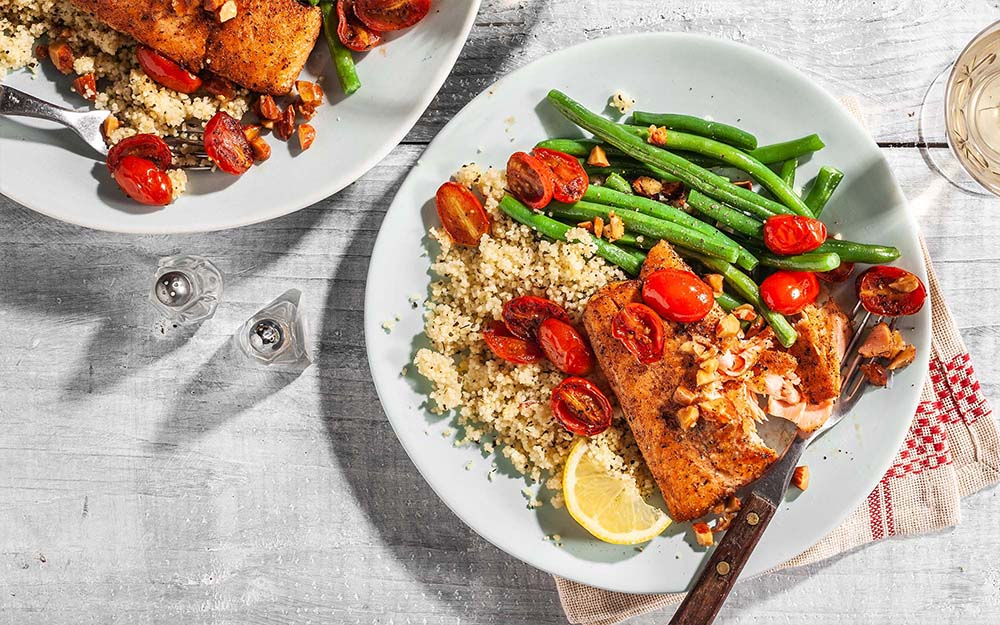 Salmon with Almond Brown Butter over herbed couscous with garlic beans,