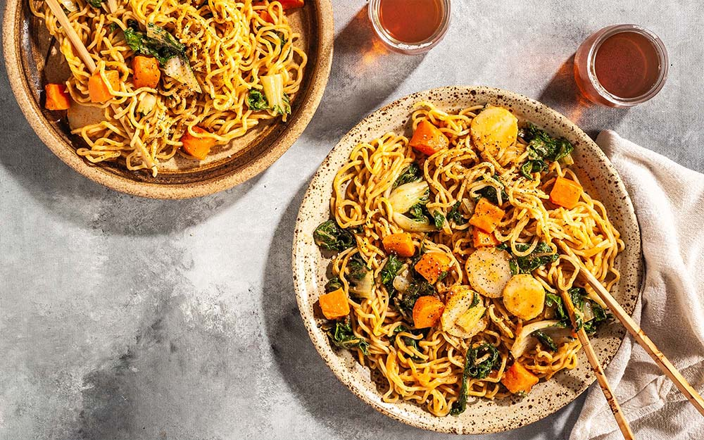 Red Curry Ramen with roasted sweet potatoes and creamy peanut sauce,