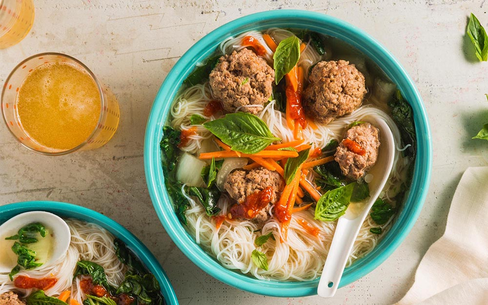 Beef Meatball Pho with noodles, Thai basil and chili sauce,