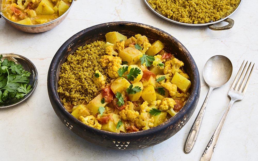 Aloo Gobi Masala simmered in a creamy tomato curry over golden quinoa, Fall Favourite