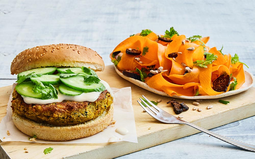 Curried Chickpea Burgers drizzled in a tahini dressing with Persian carrots and figs,