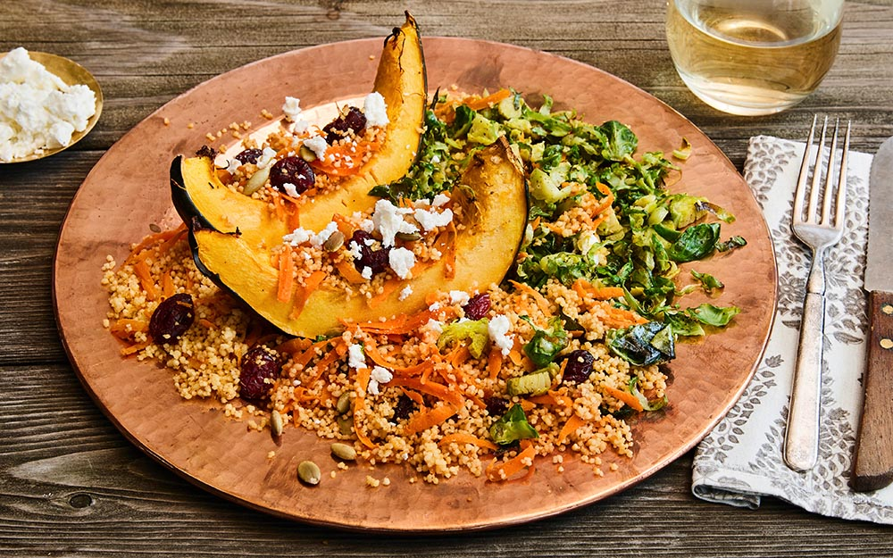 Jeweled Couscous & Goat Cheese Stuffed Squash with pepitas, cranberries and carrots,