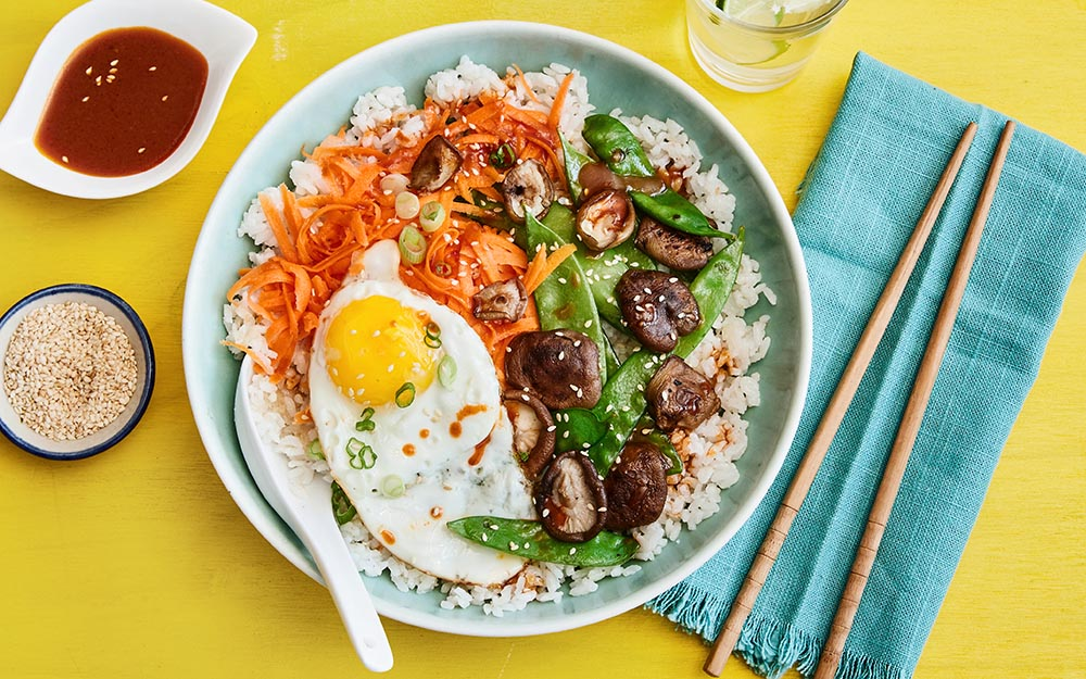 Korean Sesame Bibimbap with sticky fried rice, snow peas and spicy gochujang sauce,