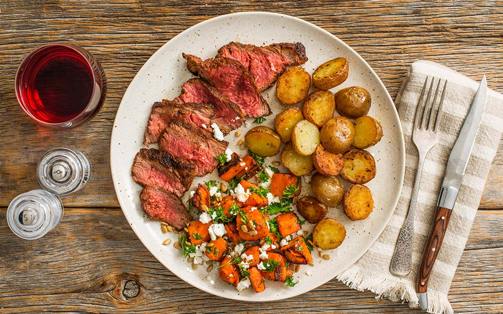 Middle Eastern Rubbed Steak with honey-lime carrots and roasted baby potatoes,