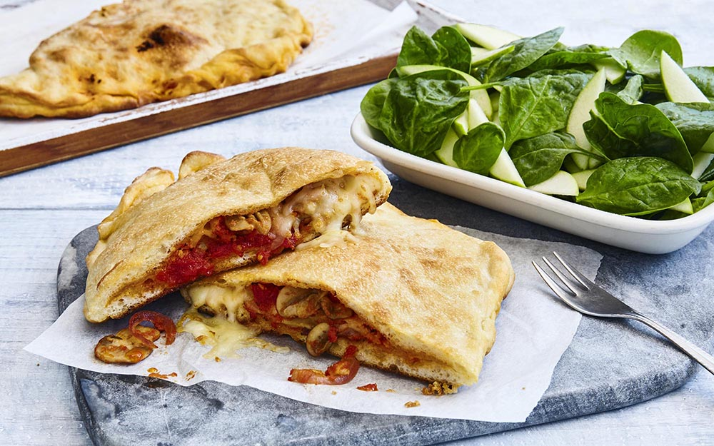 Mozzarella & Sun-dried Tomato Calzones with mushroom marinara and a spinach salad,
