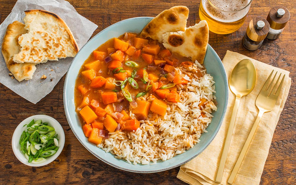 North African Butternut Squash Stew with toasted naan over rice,