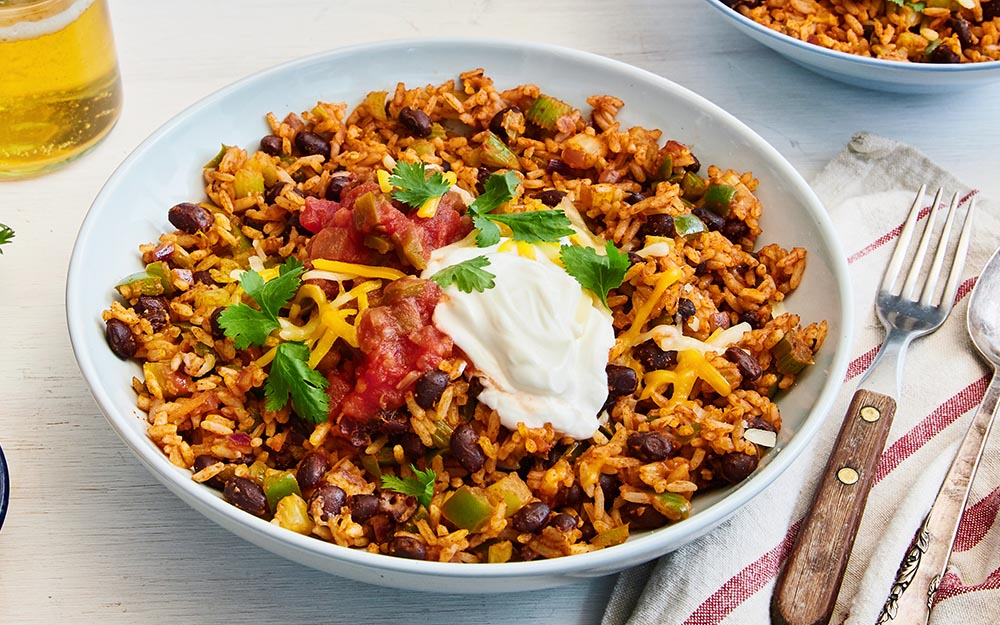One Pot Mexican Burrito Bowl with rice, peppers, cheddar and chunky tomato salsa,