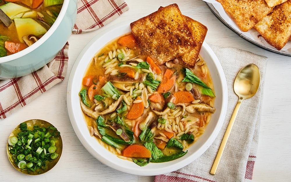 Orzo & Miso Mushroom Soup with bok choy and togarashi wonton crackers,