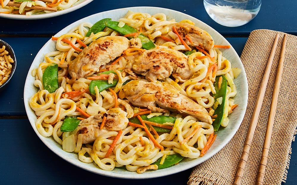 Panang Chicken & Udon Noodle Stir-fry with snow peas, shredded carrots and napa cabbage,
