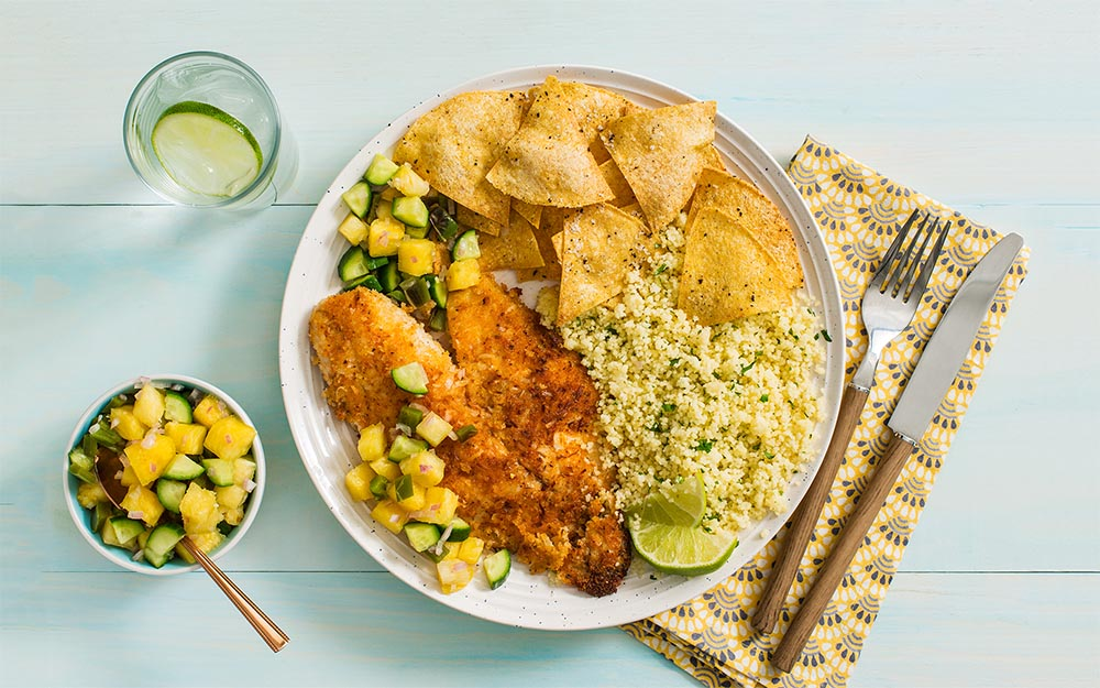 Pescado Frito Con Coco with pineapple salsa, herb couscous and tortilla chips,