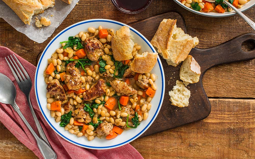 Pork Sausage Cassoulet with navy beans, herbes de Provence and French baguette,
