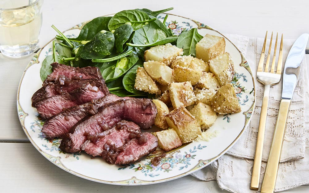 Seared Steak & Balsamic Shallot Jam with parmesan tossed potatoes and a spinach salad,
