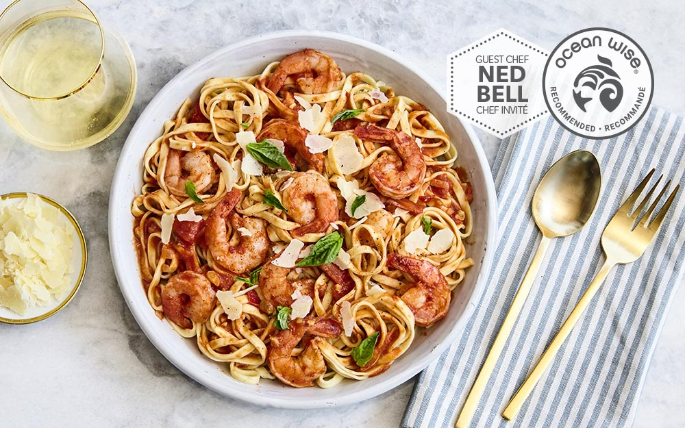 Shrimp Linguine with a garlic confit sauce and shaved parmesan cheese,