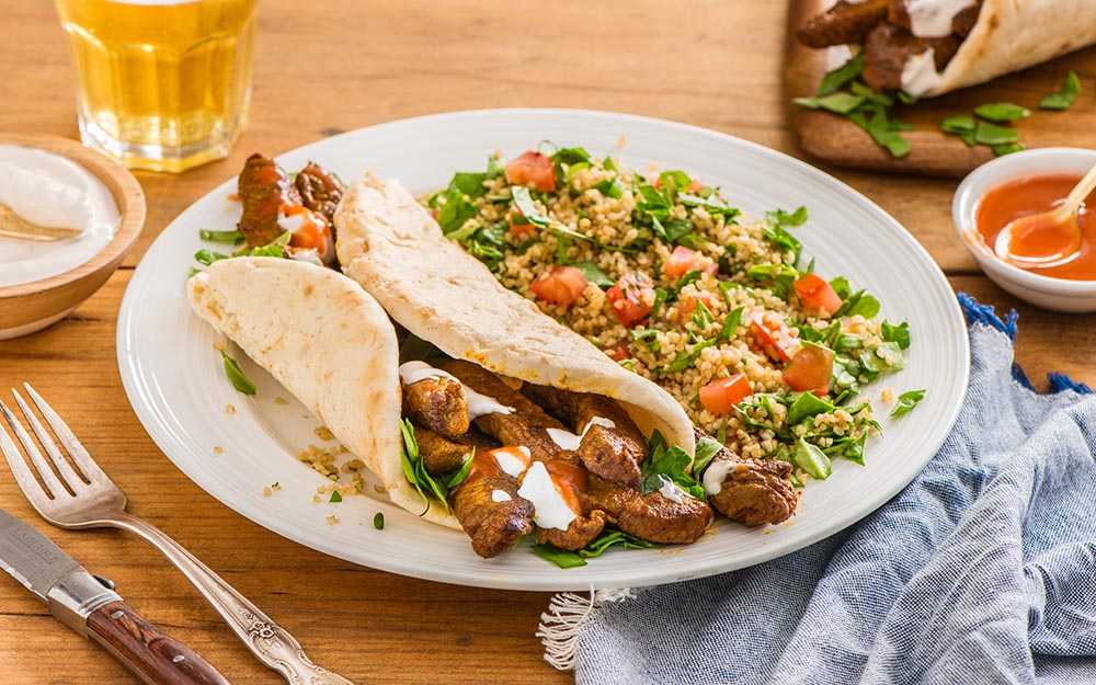 Spiced Steak Shawarmas with a cracked wheat and spinach tabbouleh,
