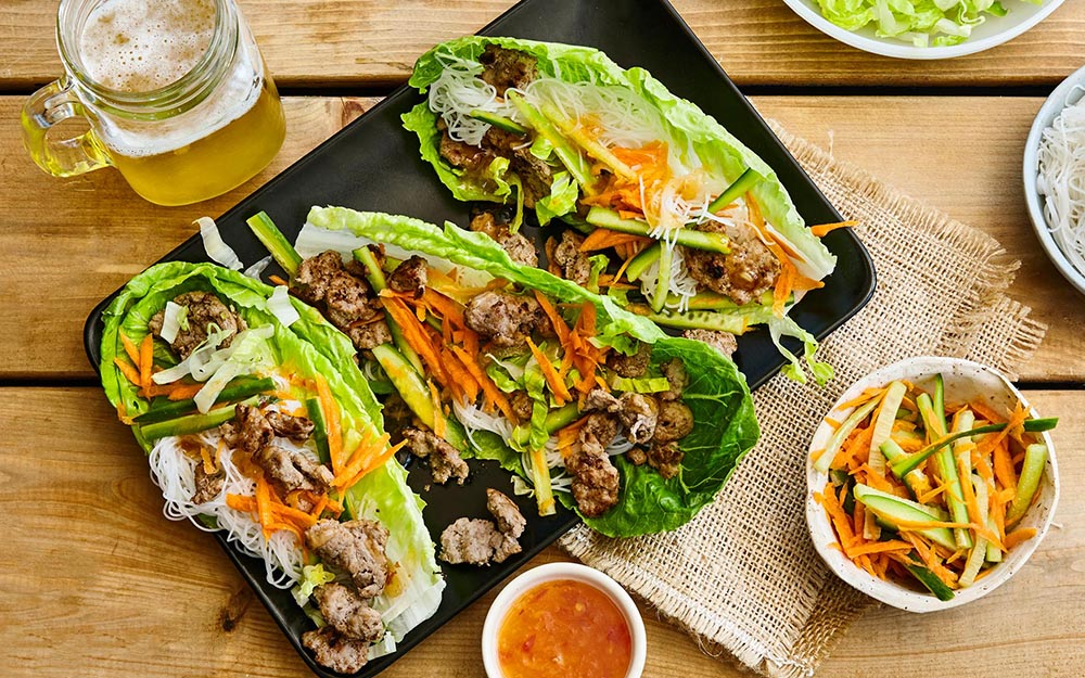 Vietnamese Pork Lettuce Wraps with quick pickles and sweet chili ginger sauce,